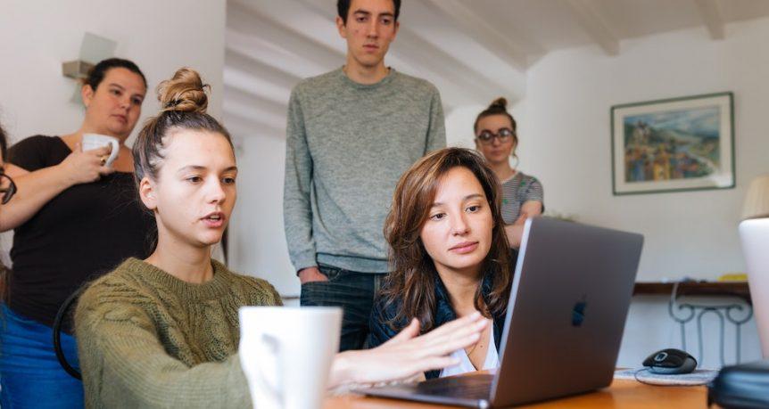 work discussion around laptop